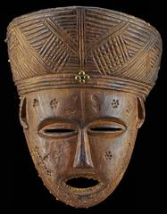 The intricate details on this Lwena dance mask were carved with a small knife.