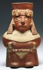 A high-ranking official of the Moche [MO-chay] people in Peru like the one pictured on this jar would have worn jewelry on his ears, wrists, and hat. 