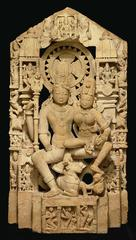 The three main Hindu gods take different forms to show their many qualities. Here Shiva, god of destruction, appears in his loving form beside his wife Parvati.