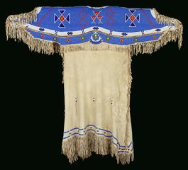 Lakota people, United States <br><i>Dress</i>, 1880-90<br>Leather, cotton, copper disks, bells, glass beads<br>Minneapolis Institute of Arts<br>Gift of James David and John David