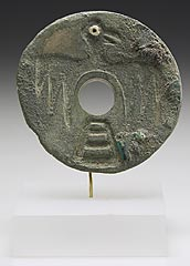 Mississippian<br>Spiro, Oklahoma<br><i>Ear spool with falcon</i>, about 1200-1350<br> Limestone, copper, shell