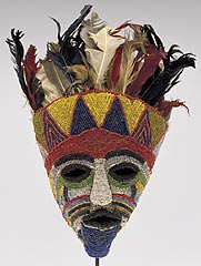 Tabwa (Zambia)<br><i><b>Mask</i></b>, late 19th–early 20th century<br>Glass beads, feathers, raffia, cloth, and skin