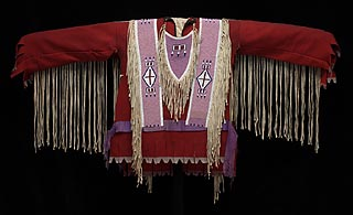 <b>A'ani/Nakoda (Gros Ventre/Assiniboine)</b><br>Northern Plains region (United States)<br><b>Shirt</b>, about 1890<br>Wool, beads, animal hide, and ribbon
